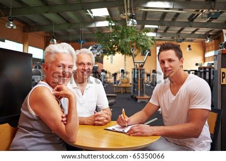 A fitness coach making a physical fitness program for two seniors