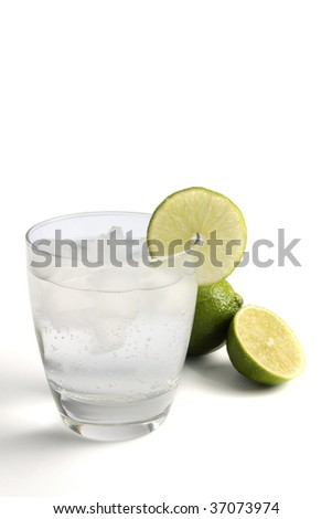 A fizzy mixed drink garnished with a lime, isolated on white.