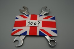 A flag of Great Britain with written,job and a question mark,above two wrenches. Unemployment concept