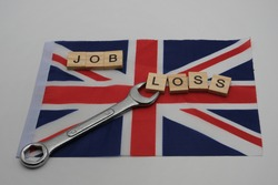 A flag of Great Britain,with written, job loss and with a wrench on it. Employment crisis concept