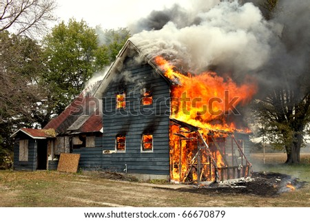 A flames of a raging fire engulf a house.