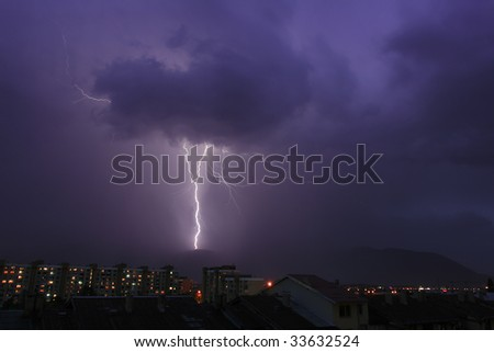 A flash of lightning in the night town