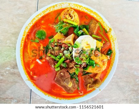 A flat lay of picture of unique and special curry mutton noodle order by a photographer to take picture and eat in Kuala Lumpur.