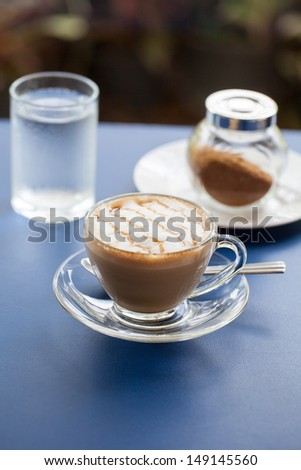 A flat white coffee with line pattern and short depth of field.