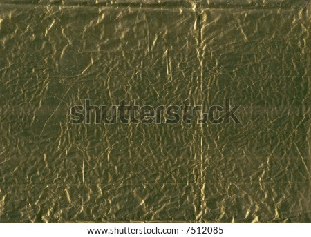 A flattened piece of gold wrapping foil, suitable as a background texture.