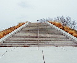 A flight of steps leading up a hill.