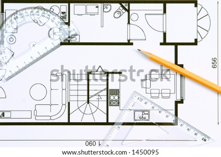 A floor plan with protractor, pencil and setsquare on top of it.