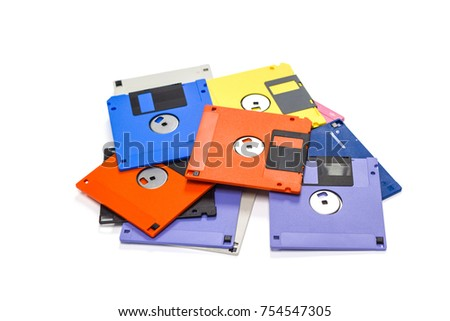 A floppy disk also called a floppy, diskette, or just disk was a ubiquitous form of data storage and exchange from the mid-1970s into the mid-2000s. isolated on white background