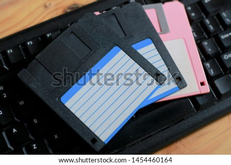 A floppy disk, also known as a floppy, diskette, or simply disk, is a type of disk storage composed of a disk of thin and flexible magnetic storage #1454460164