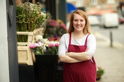 a florist outside her shop