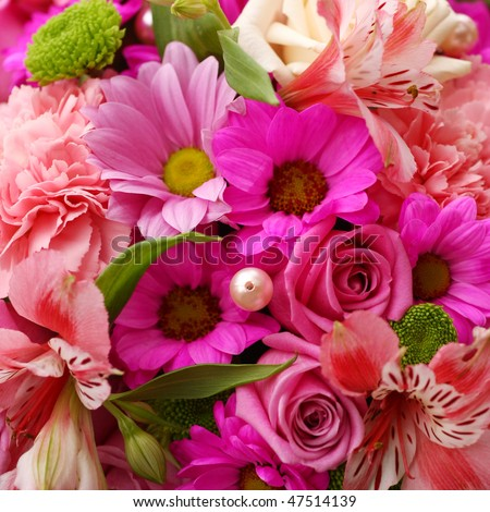 A flower bouquet with a lot of different flowers
