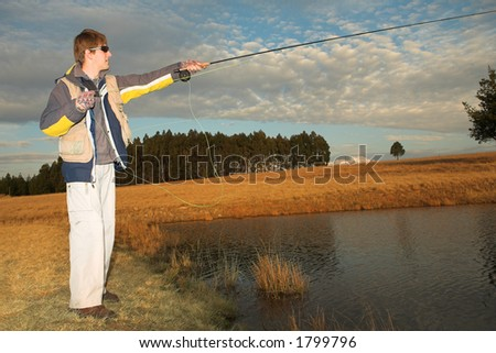 A fly fisherman casting a line in Dullstroom, South Africa