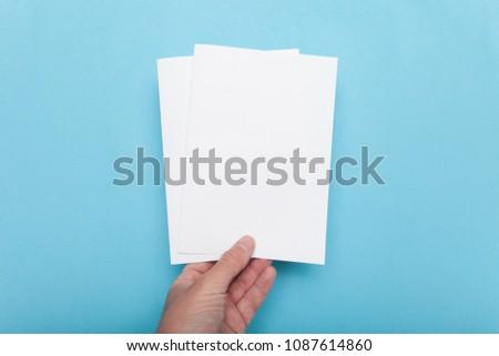 A5 flyer mockup paper brochure in hand. #1087614860
