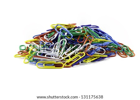 A Focus-stacked image containing a pile of colorful paper clips isolated against white with room for copy