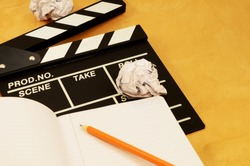 A focused image on the theme of filmaking and the writing of a script.