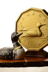 A focused theme on the Canadian Dollar currency with a Loonie coin used in the everyday money supply.