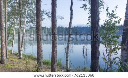 A foggy dawn over a forest lake in Russia, Chuvashia, Zaowlje #762113368