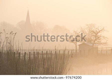 stock-photo-a-foggy-morning-in-a-typically-dutch-landscape-97674200.jpg