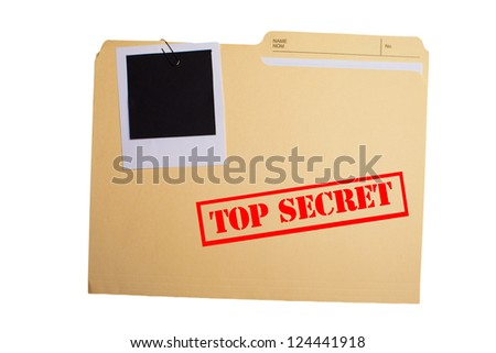 A folder with TOP SECRET stamped across the front and a blank photograph clipped to it