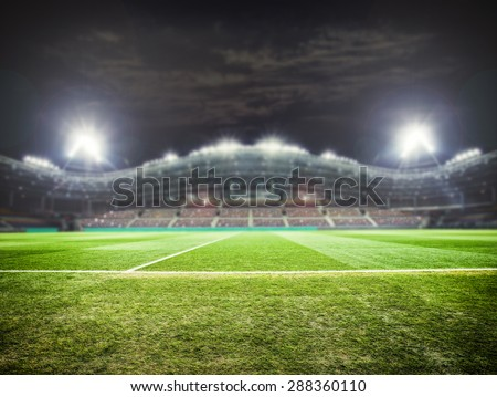 a football stadium with fans in the evening
