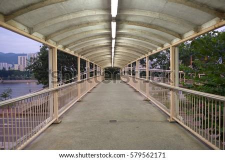A footbridge in Hong Kong in the morning. #579562171