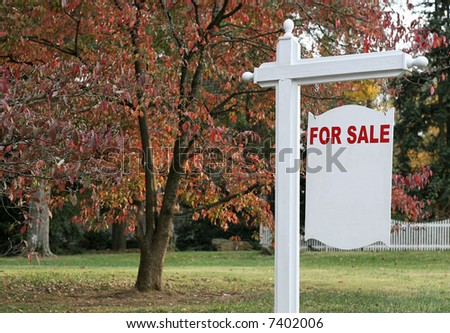 "A ""For Sale"" sign of a luxury home."