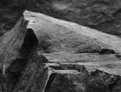 A Foreground Rock Step, Showing the Rough Texture of the Mineral Leading up to a Blurred Stone Peak.