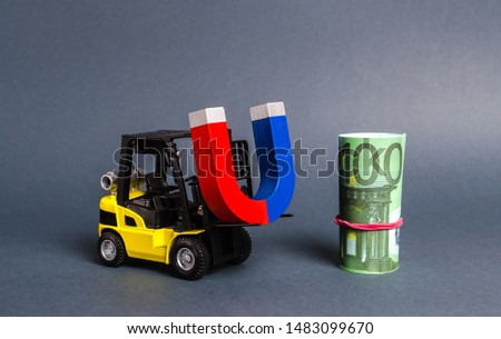 A forklift carries a magnet to a bundle of Euro. Attracting money and investments for business purposes and startups. Increase profits and attract new customers. bonus, cashback. Business strategy. #1483099670