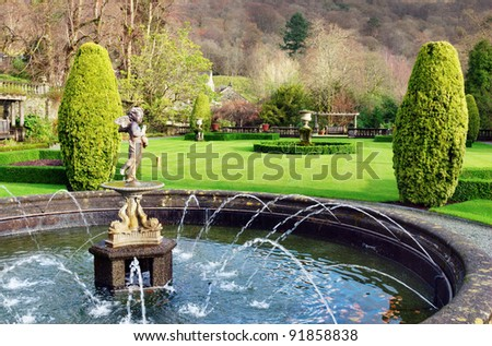 A formal fountain and garden at Rydal Hall, Rydal, Cumbria, a tranquil Christian retreat and holiday destination