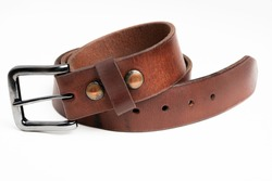 A formal studio product shot of a men's used brown leather belt with patina set on plain white background.