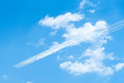 A formation of planes flying in the blue sky