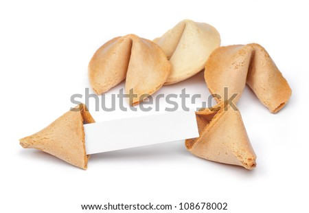 A fortune cookie with fortune paper in front of a few other cookies isolated on white.