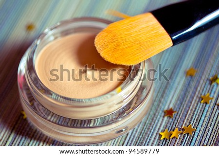 a foundation product with brush, skin care and cosmetics series
