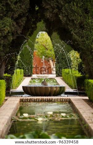A fountain in the Generalife gardens of the Alhambra palace of Granada, Spain
