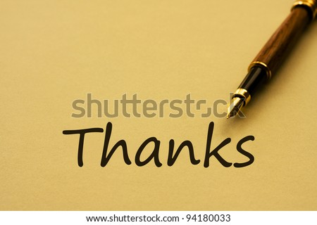 A fountain pen with yellow paper and words thanks, Writing a thank you letter