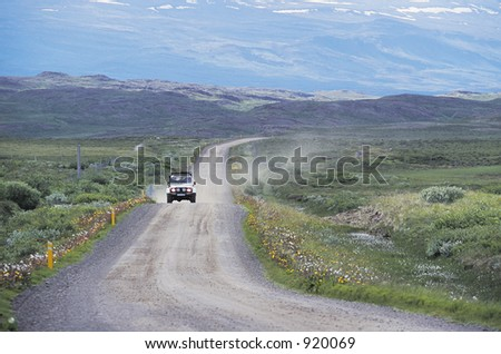 A four wheel drive vehicle drives through the Icelandic countryside