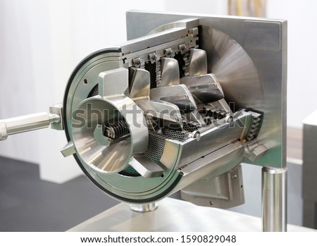 A fragment of a machine for meat processing. Cutting and processing of meat and other products. Designing machines for the food industry. Screws for meat processing. Meat grinder.