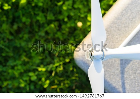 A fragment of a quadrocopter on a grass background. The blades of the unmanned aerial vehicle.  Drone repair. Spare parts for quadrocopters. The drone is ready to fly. A place for a label.