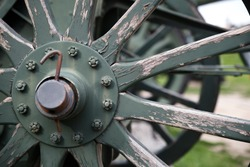 A fragment of a wheel of an old artillery piece exhibited in the open-air museum of military equipment.