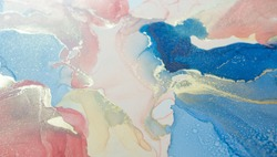 A fragment of alcohol ink painting (coral, blue and gold colors). Abstract colorful background, wallpaper. Mixing acrylic paints. Modern art. Marble texture. Alcohol ink colors translucent.