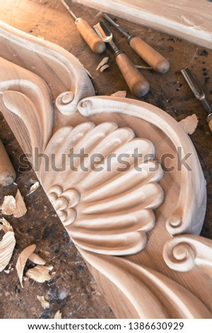 A fragment of handmade woodcarving.