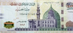 A fragment of obverse side side of 200 Egyptian pounds banknote year 2020, obverse side has an image of Mosque of Qani-Bay Cairo, Egypt. The reverse side has an image of The Seated Scribe