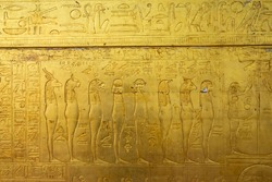 A fragment of the decor, the outer lining of the ancient Egyptian sarcophagus. The scene from the visit after the death of the pharaoh of the underworld is shown.