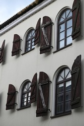 a fragment of the facade of a historic building with rhythmically arranged arched windows
