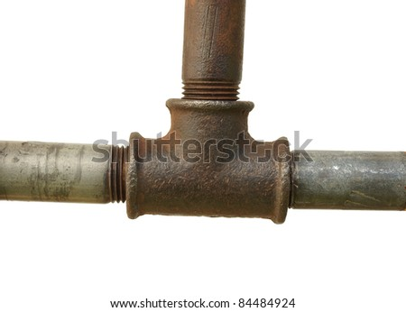 A fragment of the old water conduit consisting of pipes and fittings.