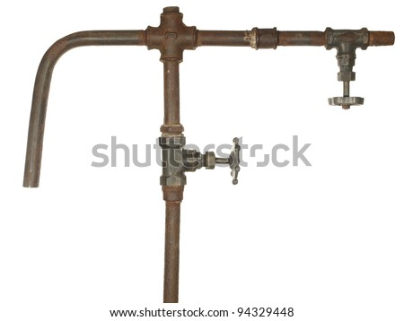A fragment of the old water conduit consisting of pipes, fittings and valve