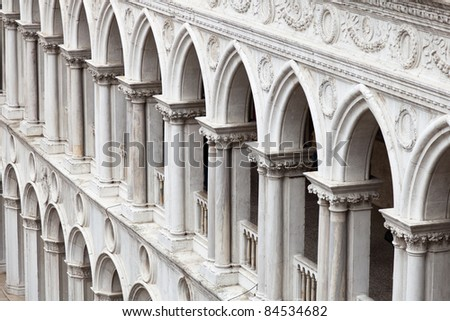 A frame filling pattern of arches from the inner façade of the Doge's Palace in Venice.