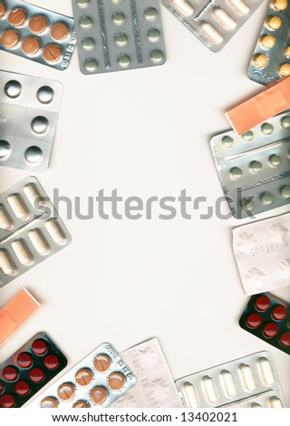 A frame made of different pills, isolated on white