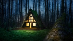 A frame triangle holiday house in the woods at night, peaceful weekend getaway in nature
