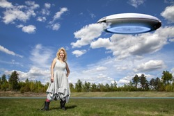 a freak woman and an alien flying saucer. Fantasy on the theme of funny madness. freak show